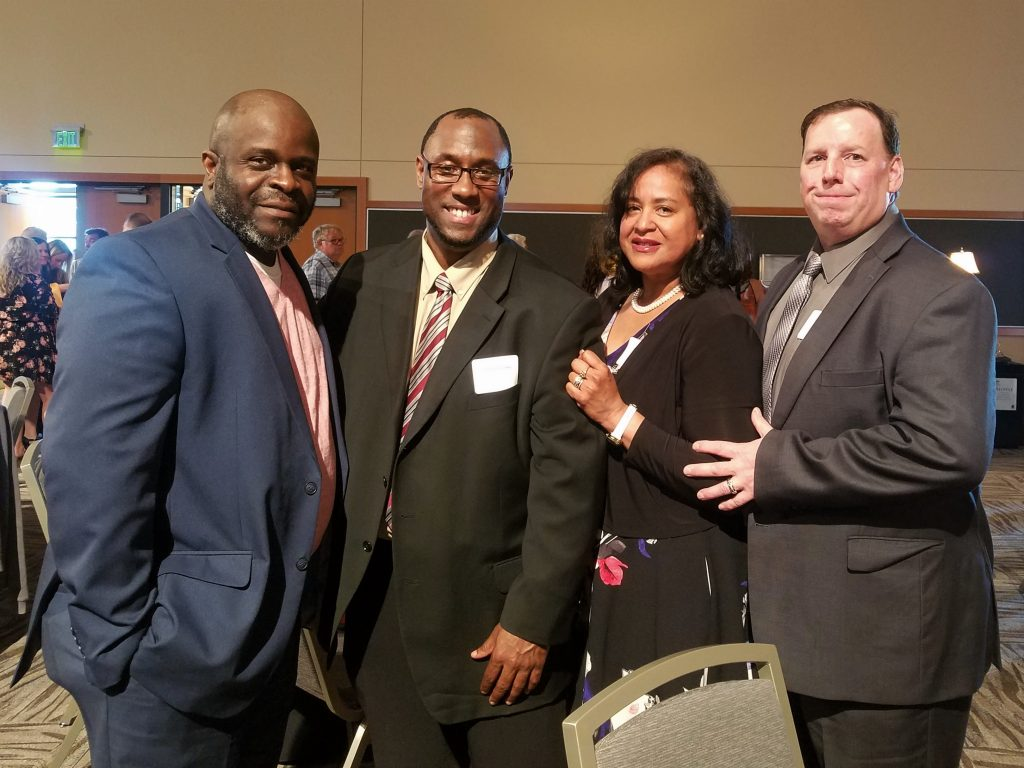 Left to right: King County Republican Party Vice Chairman Curtis Harmon, Zebulun Cobbs, Fatima Fields, and David Fields.