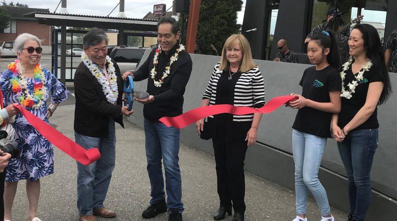 Lynnwood Times photo by Luke Putvin. Yuji Okumoto, Bob Hasegawa and others at Kona Kitchen ribbon cutting on June 22.