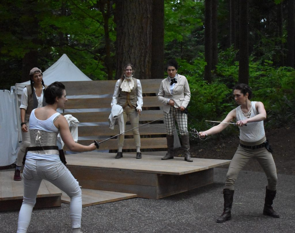 Lynnwood Times photo by Luke Putvin. Jonelle Jordan as Mercutio (Left) and Shanna Allman as Tybalt (left) at Lynndale Park for the July 17 performance of Romeo and Juliet by Seattle Shakespeare Company.
